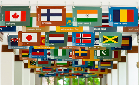 Country flags adorn the ceiling in the hallway at University of Rochester Simon Graduate S